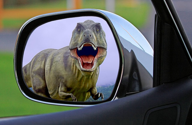Picture of a T-Rex in rearview mirror